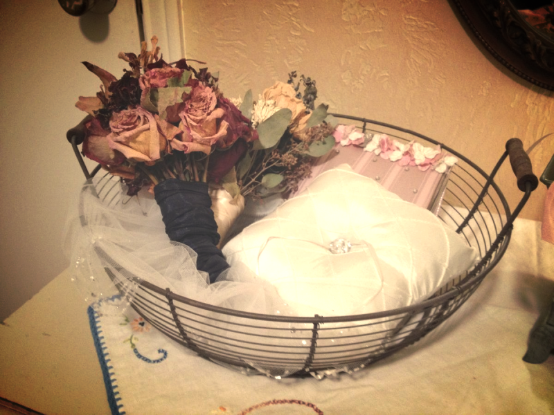 wire basket holds wedding stuff